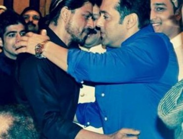 Actors Shahrukh Khan and Salman Khan during the Iftar Party hosted by Baba Siddique in Mumbai on July 6, 2014. (Photo: IANS)