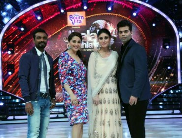 Choreographer Remo D`Souza, actors Madhuri Dixit, Kareena Kapoor Khan and filmmaker Karan Johar on the sets of Jhalak Dikhhla Jaa 7 during the promotion of film Singham Returns in Mumbai on July 29, 2014. (Photo: IANS)