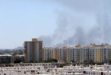 Smoke rises from the streets as heavy fighting goes on between rival militia groups in Tripoli, Libya. Deadly clashes erupted between Islamist fighters and pro-secular militias since July 13.