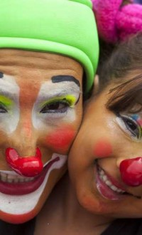 Clowns pose for photos during the sixth Latin American Congress of Clowns parade, at the Historical Center of Guatemala City, capital of Guatemala