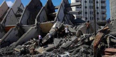 Palestinians inspect the ruins of a destroyed high-rise following Israeli airstrikes in Gaza City, early morning on Tuesday, August 26, 2014. Four huge residential high-rises were destroyed this week by Israeli war jets' missiles; three in Gaza city and one with a commercial mall in the southern Gaza Strip town of Rafah. (Xinhua/Wissam Nassar)