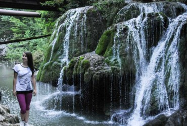 A tourist poses for photos in front of the Bigar Waterfall in Caras-Severin, southwestern Romania