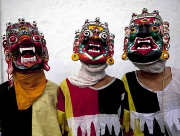 Newaris in traditional costume wear masks of Lakhey ahead of Janmashtami festival at Basantapur in Kathmandu, Nepal.