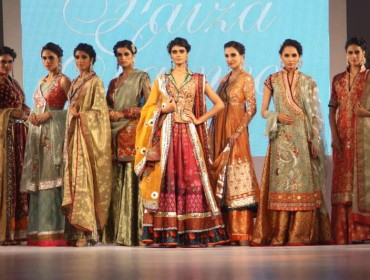 Models walk the ramp during a fashion show ahead of Aalishan Pakistan - a four-day-long lifestyle exposition organised by the Federation of Indian Chambers of Commerce and Industry (FICCI) and Trade Development Authority of Pakistan in New Delhi on Sept 10, 2014. (Photo: Amlan Paliwal/IANS)