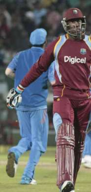 West Indian players Andre Russell walks back to the pavilion after getting dismissed during the fourth ODI match between India and West Indies at Himachal Pradesh Cricket Association Stadium, Dharmasala .