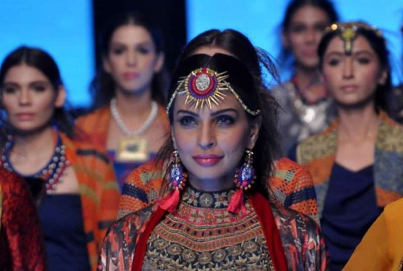 Models present creations by fashion designer FnkAsia on the second day of Pakistan Fashion Week in Karachi, Pakistan, on Nov. 26, 2014. The three-day Pakistan Fashion Week displayed works of 21 designers.
