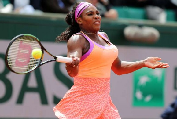 Serena Williams of the United States hits a return during the women's singles second round match against Anna-Lena Friedsam of Germany at 2015 French Open tennis tournament at Roland Garros, in Paris, France on May 28, 2015.