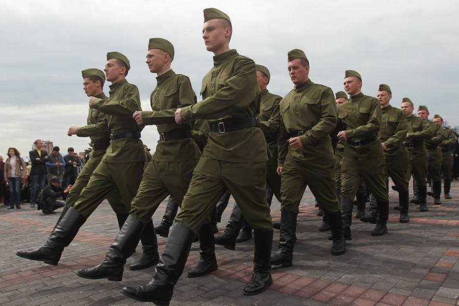 A squad of cadets participate in the Victory Day memorial ceremony marking the 69th anniversary of the defeat of Nazi Germany in WWII, in Donetsk, Ukraine