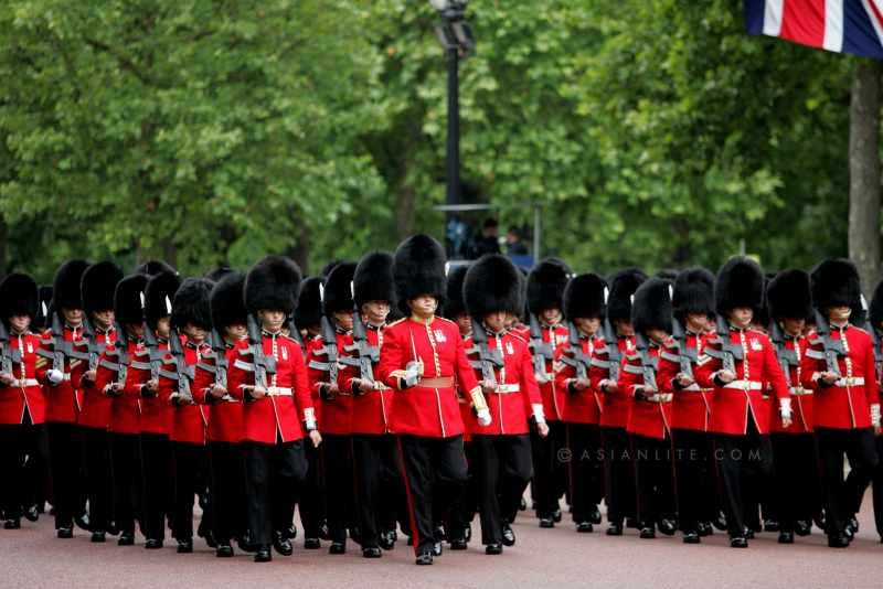 Members of the Queen's Guards march during  Trooping the Colour in London on June 14, 2014. The ceremony of Trooping the Colour is to celebrate the Sovereign's offical birthday.
