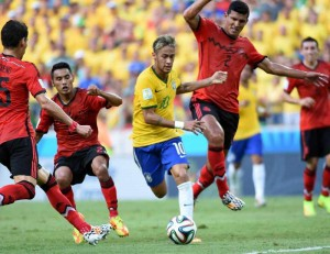 Brazil's Neymar (C) controls the ball during a Group A match between Brazil and Mexico of 2014 FIFA World Cup at the Estadio Castelao Stadium in Fortaleza, Brazil. FILE PHOTO