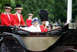 Britain's Queen Elizabeth II (L) and her husband Prince Philip attend Trooping the Colour in London on June 14, 2014. The ceremony of Trooping the Colour is to celebrate the Sovereign's official birthday.  (File)