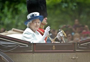 Britain's Queen Elizabeth II  and her husband Prince Philip attend Trooping the Colour in London on June 14, 2014. The ceremony of Trooping the Colour is to celebrate the Sovereign's official birthday.