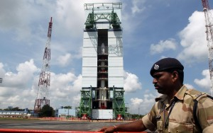 pslv rocket Paramilitary soldiers guard the Polar Satellite Launch Vehicle (PSLV-C25) at Satish Dhawan Space Center at Andhra Pradesh's Sriharikota on Oct.30, 2013. India's Mars orbiter mission is scheduled to be launched by the Polar Satellite Launch Vehicle (PSLV-C25) on Nov. 5. (Photo: IANS)
