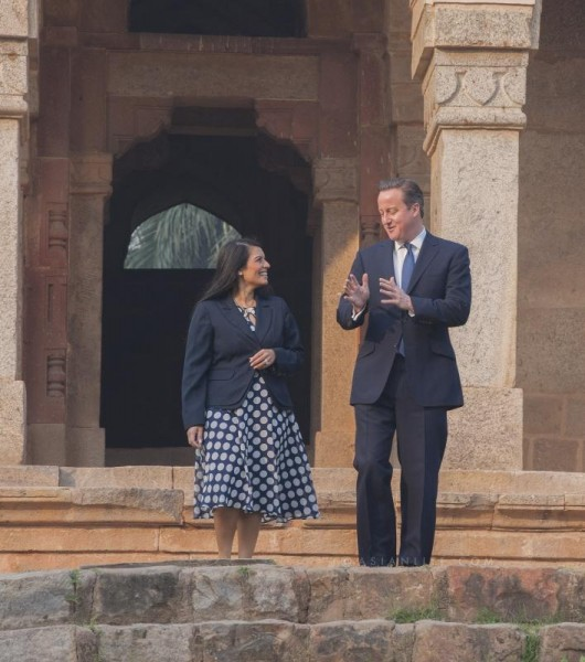 British Prime Minister David Cameron with Priti Patel MP, Minister of State for Employment at the Department for Work and Pensions