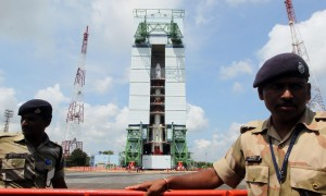Paramilitary soldiers guard the Polar Satellite Launch Vehicle (PSLV-C25) at Satish Dhawan Space Center at Andhra Pradesh's Sriharikota on Oct.30, 2013. India's Mars orbiter mission is scheduled to be launched by the Polar Satellite Launch Vehicle (PSLV-C25) on Nov. 5. (Photo: IANS)