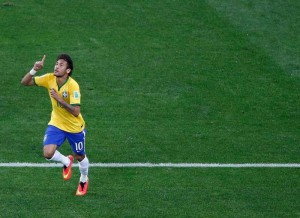 Neymar celebrates his first goal against Croatia.
