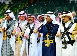 Saudi Arabia's second deputy Prime Minister Muqrin bin Abdulaziz (3rd L) and visiting Britain's Prince Charles (2nd L) perform traditional Saudi dance known as `Arda` during Janadriya Culture Festival in Riyadh on Feb.18, 2014. (Photo: Xinhua/IANS)