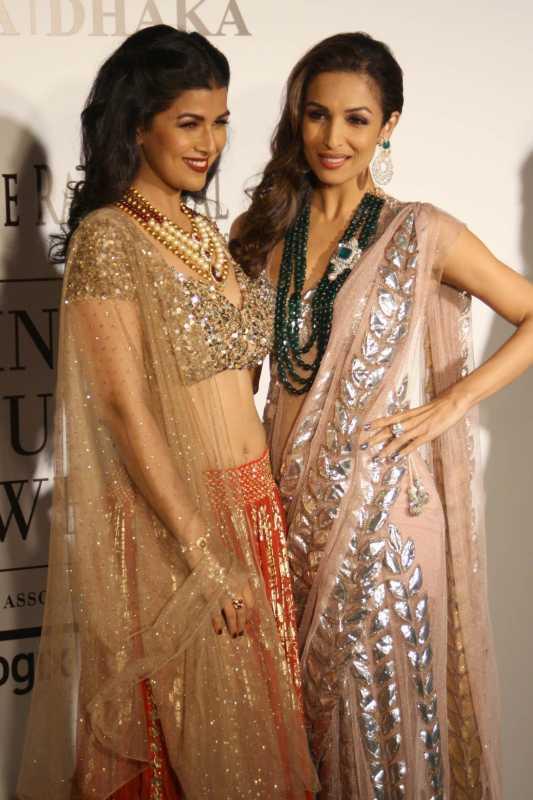 Bollywood actress Malaika Arora Khan and Nimrat Kaur pose for photos with a dress created by Indian designer Rina Dhaka at the India Couture Week 2014 in New Delhi, on July 16, 2014. (Photo: IANS/Amlan Paliwal)