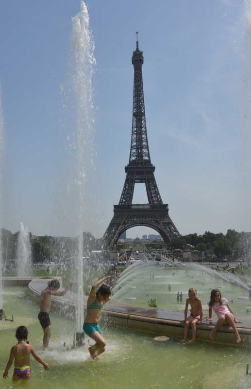 PARIS:  People cool themselves in a fountain near Eiffel Tower in Paris, France