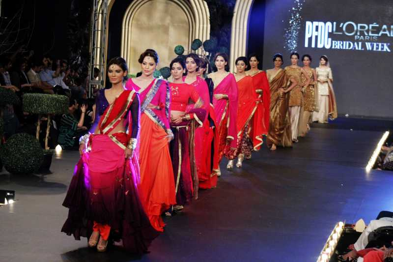 Models present creations by designer Sadaf Malaterre on the second day of the Pakistan Fashion Design Council (PFDC)'s Bridal Week in eastern Pakistan's Lahore