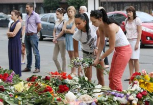 People pay tribute to the victims