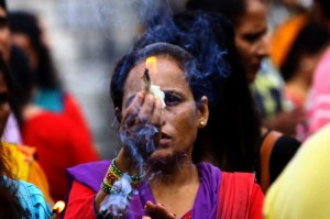 A Hindu woman offers prayers on Shrawan Somvar at Pashupatinath temple in Kathmandu, Nepal. Shrawan Somvar (Monday) is considered auspicious for offering prayer to Lord Shiva for the long and prosperous life for their husbands.