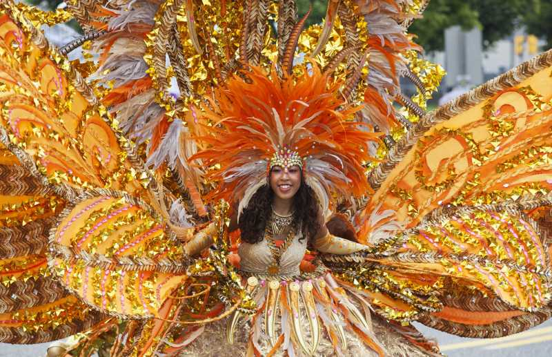 A girl performs with her float during the Junior Parade of the 2014 annual Toronto Caribbean Carnival in Toronto, Canada, July 19, 2014. As the largest Junior Parade of its kind in North America, this annual event kicked off here on Saturday