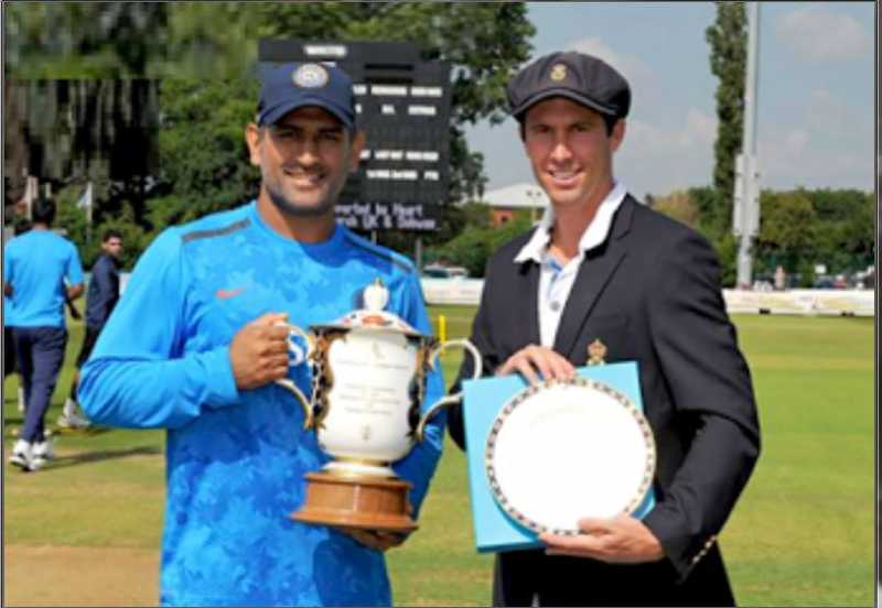 MS Dhoni & Wayne Madsen (captain of Derbyshire) with the Royal Crown Derby Trophy and Plate during tour match between Derbyshire and India
