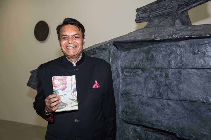 Satish Modi with his book In Love With Death