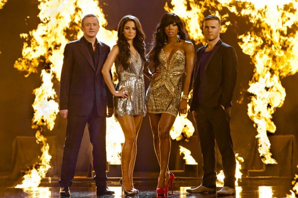 Tulisa (second from left) along with her X-Factor team mates