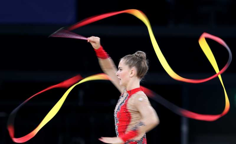 Lauren Brash of Scotland competes during the ribbon competition of the Team Final and Individual qualification of Gymnastics Rhythmic at the 2014 Glasgow Commonwealth Games in Glasgow, Scotland, July 24, 2014. Scotland took the seventh place with a total point of 109.625.