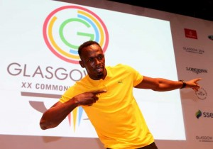 Usain Bolt of Jamaica poses for aphoto during a press conference on day 3 of the Glasgow 2014 Commonwealth Games