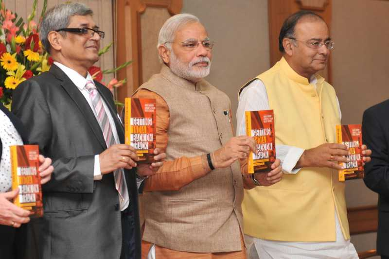 """Prime Minister,Narendra Modi releasing the book """"Getting India Back on Track"""" An Action Agenda for Reform, in New Delhi on June 8, 2014. The Union Minister for Finance, Corporate Affairs and Defence, Shri Arun Jaitley is also seen"""