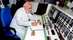 The Prime Minister, Shri Narendra Modi signing the visitors book, during his visit at the Bhabha Atomic Research Centre (BARC), in Mumbai on July 21, 2014.