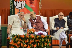 BJP President Amit Shah in consultation with Prime Minister Narendra Modi during the BJP National Council meeting in New Delhi on Aug. 9, 2014. (Photo: IANS)