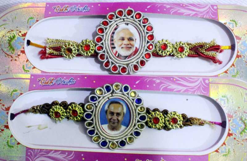 Rakhis with pictures of Prime Minister Narendra Modi and Odisha Chief Minister Naveen Patnaik on sale at a shop in Cuttack of Odisha