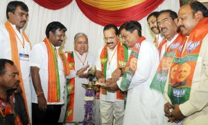 Union Railway Minister DV Sadananda Gowda with BJP leader Govind Karjol and others during a BJP meeting in Bangalore