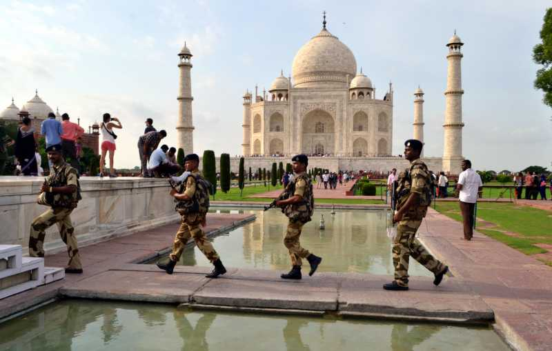 CISF personnel personnel patrol Taj Mahal in Agra on Aug 14, 2014. (Photo: Pawan Sharma/IANS)