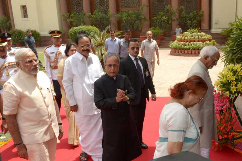 President Pranab Mukherjee with Vice President Hamid Ansari, Prime Minister Narendra Modi, Lok Sabha speaker Sumitra Mahajan and Union Parliamentary Affairs Minister M Venkaiah Naidu attending both the House of Parliament at Central Hall in Parliament House on June 9, 2014.