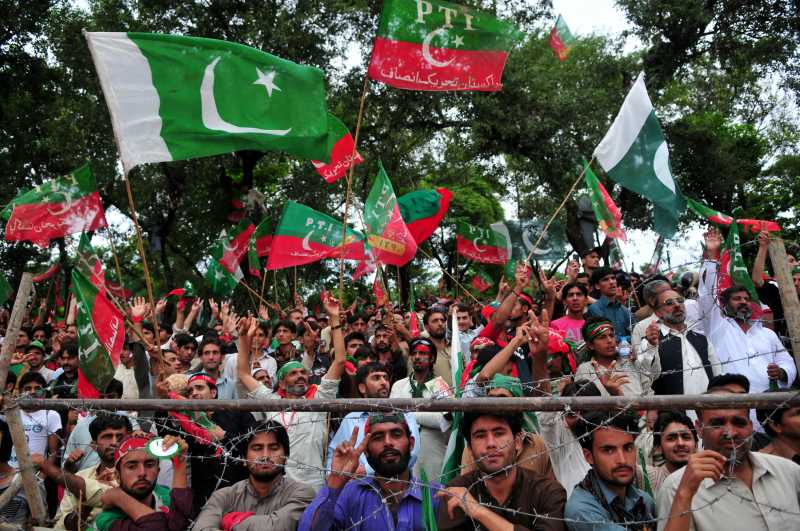- Supporters of Pakistani political leader Imran Khan wave flags as they take part in a protest against the country's ruling Pakistan Muslim League-Nawaz in Islamabad, capital of Pakistan on Aug. 16, 2014. Senior Pakistani political leader Imran Khan on Saturday demanded Prime Minister Nawaz Sharif resign and new elections be held as last year's polls were rigged. (Xinhua/Ahmad Kamal)