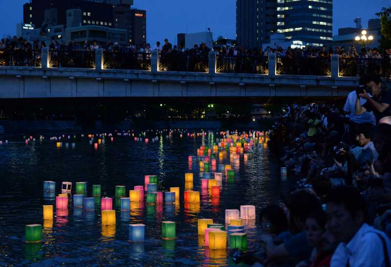 Paper lanterns float along the Motoyasu River in front of the Atomic Bomb Dome in Hiroshima, western Japan
