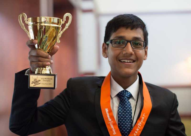 2014 Microsoft Office Specialist World Champion in PowerPoint 2010, Arjit Kansal from India with his trophy in Anaheim, California, United States of America on Aug 4, 2014. (Photo: IANS)
