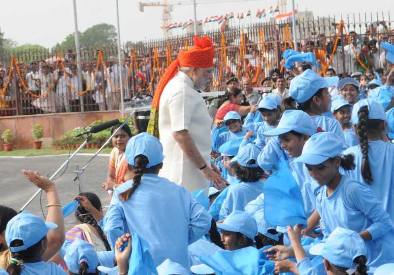 Prime Minister Narendra Modi interacts with children after addressing the nation on the occasion of 68th Independence Day from the ramparts of Red Fort, in Delhi
