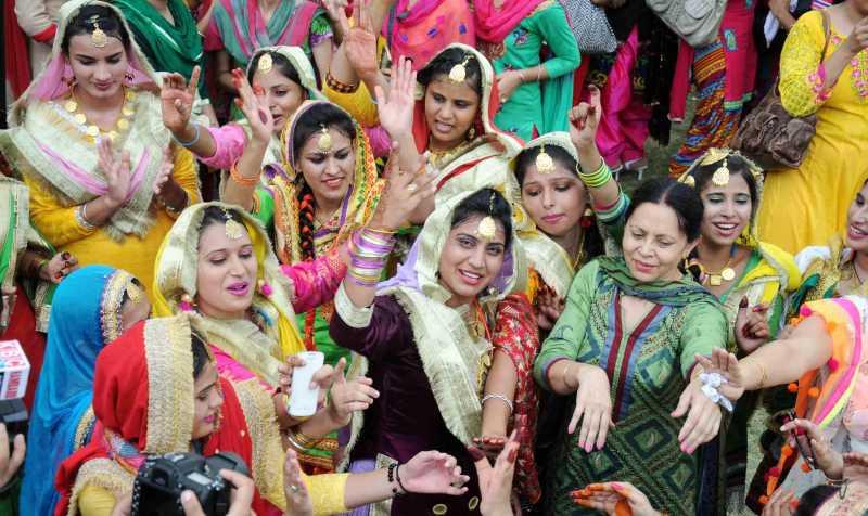 Girls celebrate Teej festival in Amritsar on August 2, 2014. (Photo: IANS)