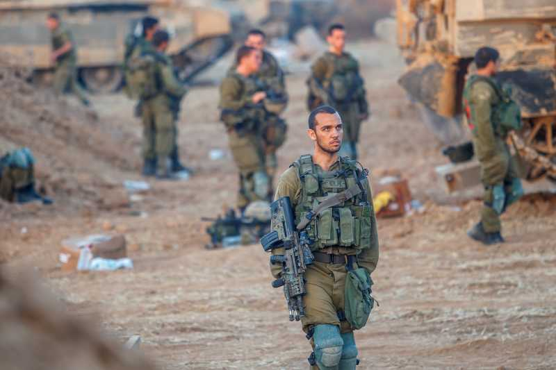 Israeli soldiers from the Golani Brigade are seen at a staging area before entering Gaza from Israel