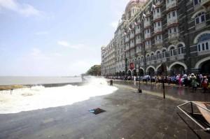 High tide and sea waves infront of the Taj Hotel in Mumbai on June 13, 2014. (Photo: Sandeep Mahankal/IANS)