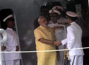 Prime Minister Narendra Modi with Admiral RK Dhowan, Chief of Naval Staff during the commissioning ceremony of INS Kolkata at the Naval Dockyard in Mumbai on August 16, 2014. (Photo: Sandeep Mahankal/IANS)