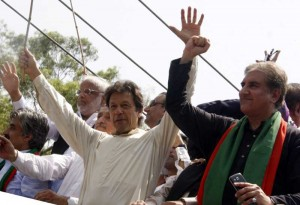 Pakistan senior opposition leader Imran Khan  gestures as he heads a protest march from Lahore to Islamabad against the government, in east Pakistan's Lahore on Aug. 14, 2014. Imran Khan, a former cricket icon, on Thursday started an anti-government march from the eastern city of Lahore. FILE PHOTO