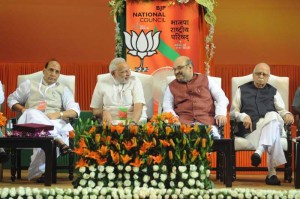 Former BJP President and Union Home Minister Rajnath Singh, Prime Minister Narendra Modi, Newly appointed BJP President Amit Shah and Senior BJP leader L K Advani at the BJP National Council meeting in New Delhi on Aug 9, 2014. (Photo: IANS)