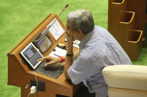 Goa Chief Minister Manohar operates a tab on the first day of Goa Assembly session which is now 95 % paperless at Goa Assembly Complex in Porvorim, Goa on July 22, 2014. (Photo: IANS)